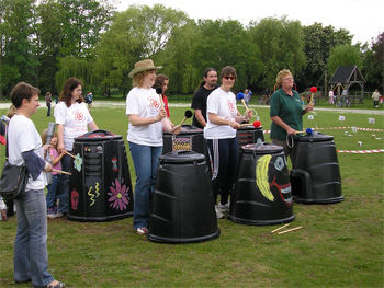 York Rotters performing compost bin drumming in Rowntree Park, 13 May2007