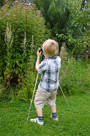 James learning to use a tripod