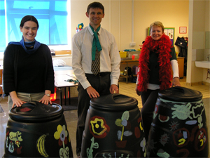 Mrs Finn, Mr Robinson and Dr Wannop with the compost bins Year 4 had decorated