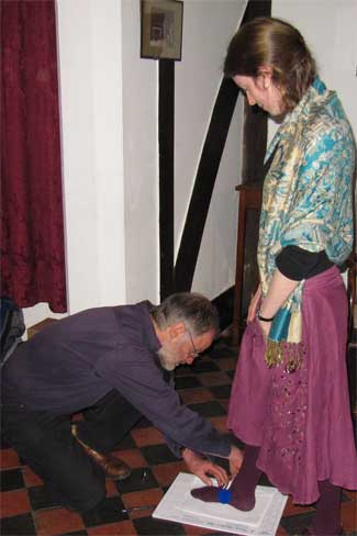 Terry measuring Catherine up for a pair of shoes