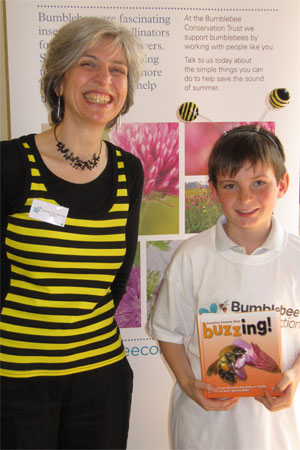 Me with one of the prize-winning children and his copy of my Buzzing! book