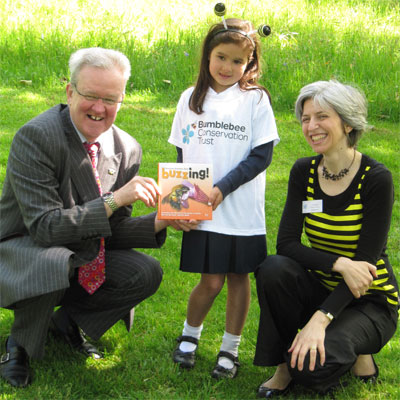 With Environment Minister, Stewart Stevenson MSP presenting a copy of my Buzzing! book to a young bumblebee artist