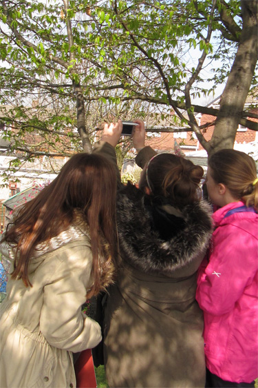 Taking photos of the Spring at Ackton Pastures Primary School