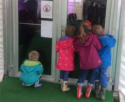 Welly boot wearers peeking in as I was setting up for my Buzzing! show at Hay