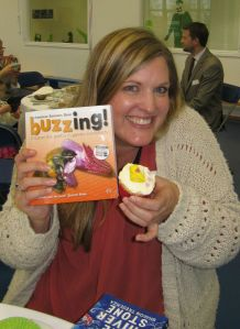 The Book Bun lady, with her copy of Buzzing!