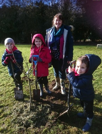 Naburn Primary School children with one of their new apple trees