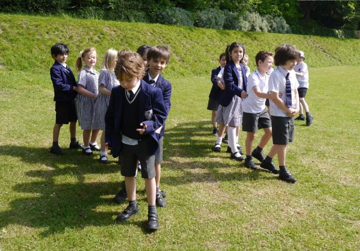 Rose Court Year 2 pupils being millipedes (Photo by Rachel Cockburn)