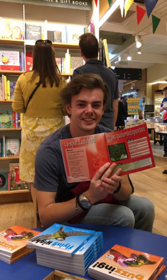 Marcus in Waterstones, York, with Buzzing! open at the Marcus page (p. 148), named after him!