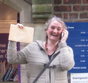 The fabulous Jess, at Easingwold Community Library, with the 'Treasure' envelope